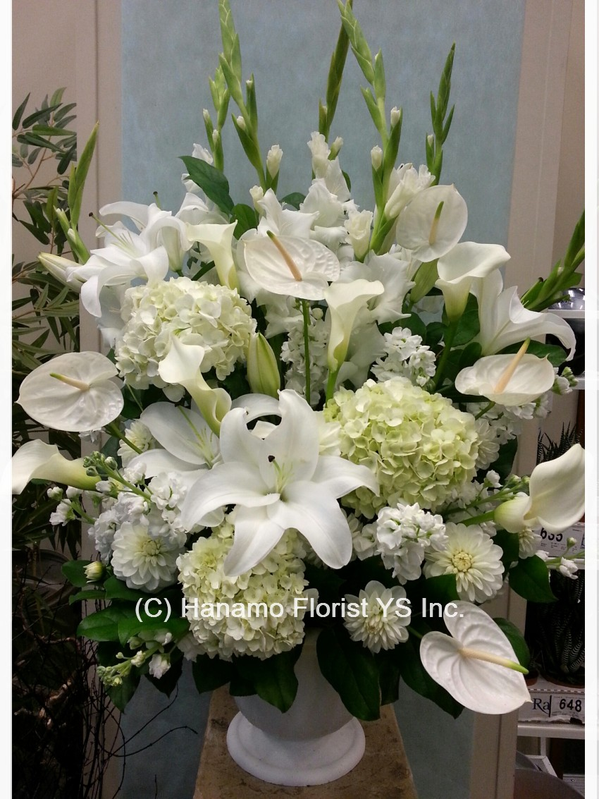 Funeral sympathy hanamo florist online store vancouver bc symp629 most elegant arrangement with all white flowers izmirmasajfo