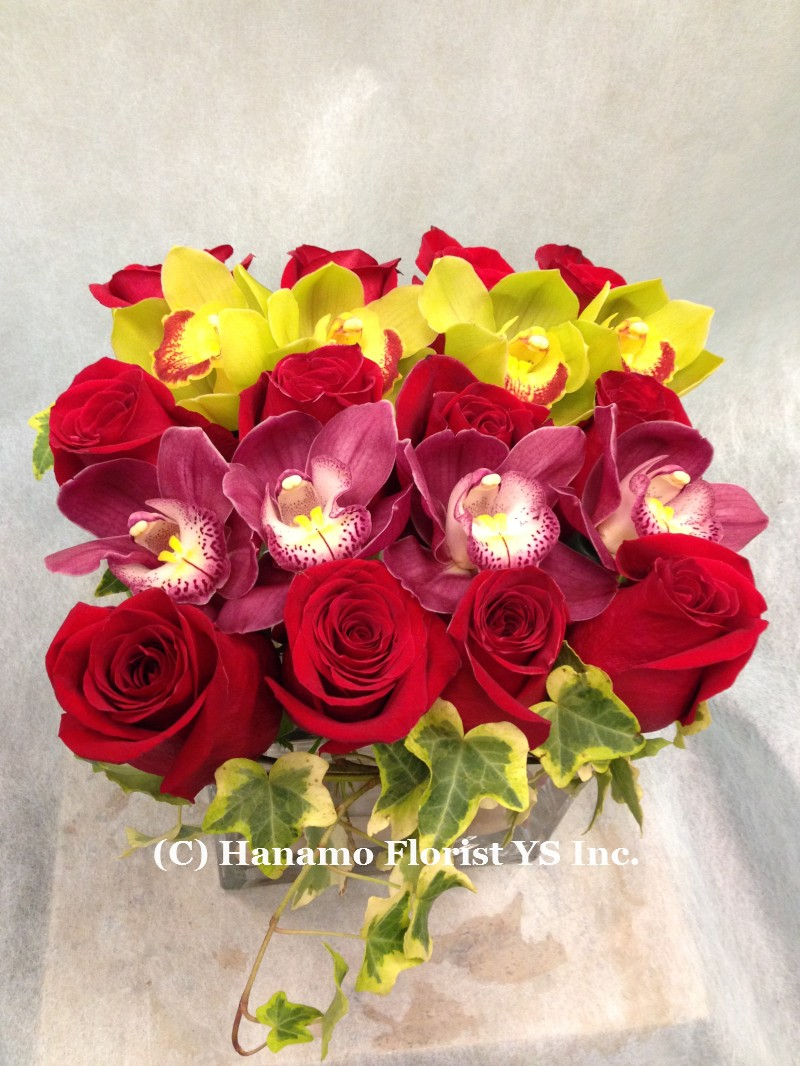 "HANA204 Dozen Roses & Cymbidiums in a 6"" Cube Glass"